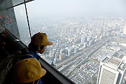 child looking out over Tokyo from observation deck of the Landmark Tower the tallest building in Japan