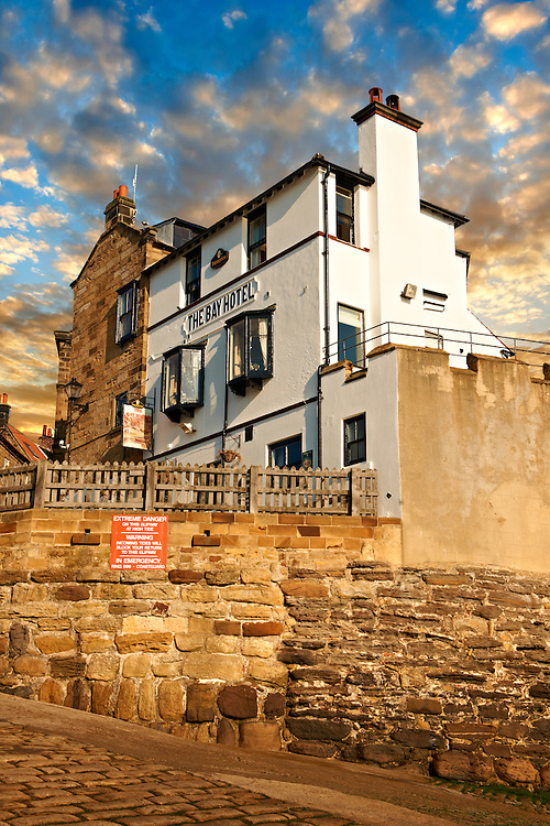 Bay Hotel & fishermans houses of the historic fishing village of Robin Hood's Bay, Near Whitby, North Yorkshire, England. .<br /> <br /> Visit our ENGLAND PHOTO COLLECTIONS for more photos to download or buy as wall art prints https://funkystock.photoshelter.com/gallery-collection/Pictures-Images-of-England-Photos-of-English-Historic-Landmark-Sites/C0000SnAAiGINuEQ