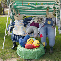 Stufed giant bunnies are seen sitting in a swingbed as part of the Easter celebration in Somogyaszalo (about 170 km South-West of capital city Budapest), Hungary on April 14, 2017. ATTILA VOLGYI