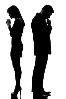 one caucasian sad couple back to back man thinking and woman crying standing back to back man and woman in studio silhouette isolated on white background