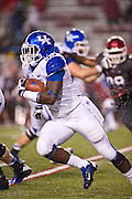 Kentucky Wildcats running back Dyshawn Mobley (33) carries the ball during the second half of a game against the Arkansas Razorbacks at Donald W. Reynolds Razorback Stadium in Fayetteville, Ark., on Oct.. 13, 2012. Photo by Beth Hall