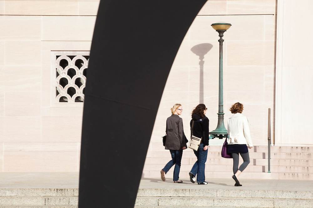 Three women walk towards the entrance of the National Gallery of Art on the National Mall, Washington DC.
