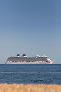 P&O Cruises' largest ship, Britannia, at anchor in Weymouth Bay. The cruise industry has suffered a complete shutdown during the covid-19 pandemic and many vessels are currently waiting at various anchorages around the coast of Great Britain and the world.<br /> Picture date Tuesday 1st September, 2020.<br /> Picture by Christopher Ison. Contact +447544 044177 chris@christopherison.com