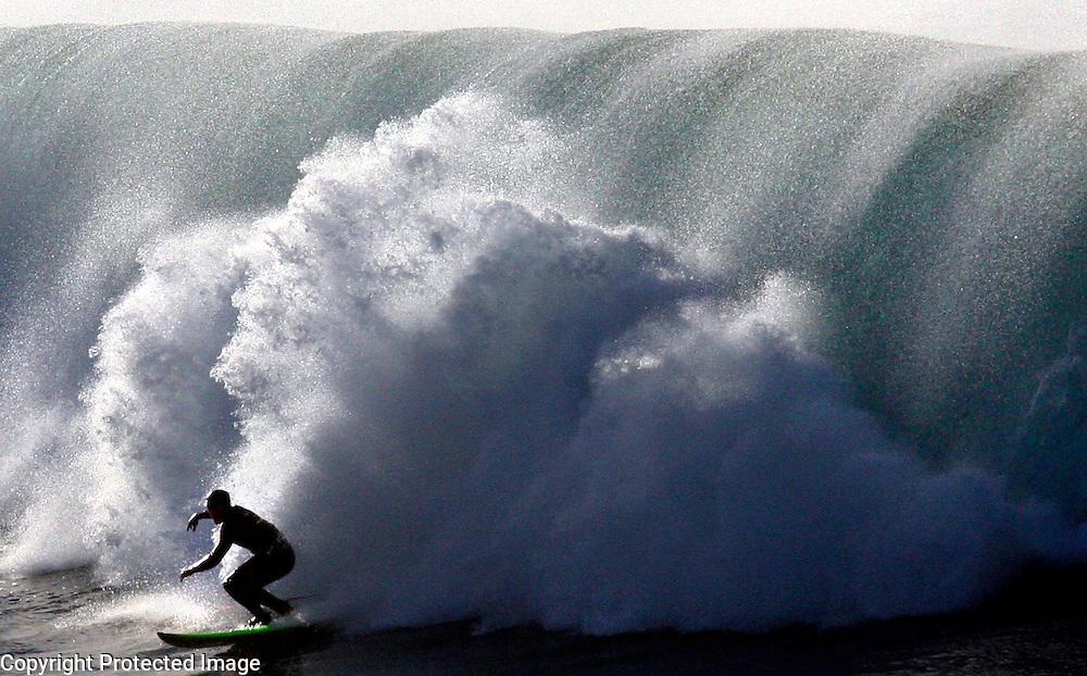 A surfer shoots out of the spray as a large wave crashes at Steamer Lane in Santa Cruz, California.<br /> Photo by Shmuel Thaler <br /> shmuel_thaler@yahoo.com www.shmuelthaler.com
