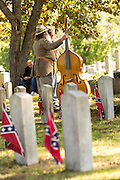 Civil war re-enactors play Dixie during a memorial service at Elmwood Cemetery to mark Confederate Memorial Day May 2, 2015 in Columbia, SC. Confederate Memorial Day is a official state holiday in South Carolina and honors those that served during the Civil War.