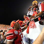 Louisville Cardinals quarterback Teddy Bridgewater (5) celebrates with his mother, Rose Murphy, after the NCAA Football Russell Athletic Bowl football game between the Louisville Cardinals and the Miami Hurricanes, at the Florida Citrus Bowl on Saturday, December 28, 2013 in Orlando, Florida. Louisville won the game by a score of 36-9. (AP Photo/Alex Menendez)