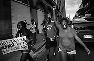 "Protesters in New Orleans  take to the streets of the French Quarter after a vigil for Mark Brown, part of a  protest in solidarity with the people of Ferguson Missouri, part of a held across the country. They chanted  ""hands up, don't shoot,."""