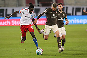Fussball: 2. Bundesliga, FC St. Pauli - Hamburger SV, Hamburg, 01.03.2021<br /> Bakery Jatta (HSV, l.) - Philipp Ziereis (Pauli)<br /> © Torsten Helmke