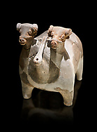 Bronze Age Anatolian terra cotta vtwo headed bull shaped ritual vessel - 19th to 17th century BC - Kültepe Kanesh - Museum of Anatolian Civilisations, Ankara, Turkey.  Against a black background. .<br /> <br /> If you prefer to buy from our ALAMY PHOTO LIBRARY  Collection visit : https://www.alamy.com/portfolio/paul-williams-funkystock/kultepe-kanesh-pottery.html<br /> <br /> Visit our ANCIENT WORLD PHOTO COLLECTIONS for more photos to download or buy as wall art prints https://funkystock.photoshelter.com/gallery-collection/Ancient-World-Art-Antiquities-Historic-Sites-Pictures-Images-of/C00006u26yqSkDOM