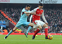 Football - 2016 / 2017 Premier League - Arsenal vs. Burnley<br /> <br /> Granit Xhaka of Arsenal and Dean Marney of Burnley at The Emirates.<br /> <br /> COLORSPORT/ANDREW COWIE