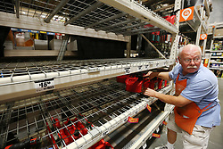 September 5, 2017 - Lady Lake, FL, USA - Ed Fluker arranges the last remaining gas containers on otherwise empty shelves at The Home Depot in Lady Lake on Tuesday afternoon, Sept. 5, 2017. The empty shelves beside him are where the generators are typically displayed. The store was out of generators and water early Tuesday. Buyers at the store are preparing for Hurricane Irma. (Credit Image: © Stephen M. Dowell/TNS via ZUMA Wire)