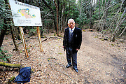 Yoshifumi Yamada, chairman of the Lake Shoji Tourism Association, stands at the entrance to Aokigahara Jukai, better known as the Mt. Fuji suicide forest, which is located at the base of Japan's famed mountain west of Tokyo, Japan. ..