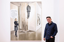 "© Licensed to London News Pictures. 28/11/2019. LONDON, UK. Polish artist Marcin Maciejowski poses with his work ""It Certainly Has A Fairly Intriguing - Strange Composition"", 2019.  First look of ""Private View"" by Marcin Maciejowski at Galerie Thaddeus Ropac in Mayfair.  The artist's first London exhibition features new large-scale paintings and graphic works on paper merging comic-book and Old Master traditions.  The show runs 28 November to 25 January 2020. Photo credit: Stephen Chung/LNP"