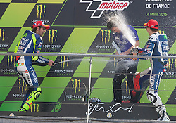 17.05.2015, Circuit, Le Mans, FRA, MotoGP, Grand Prix von Frankreich, im Bild Die Siegerehrung mit einer Sektdusche 99 Jorge Lorenzo / Spanien, 46 Valentino Rossi / Italien // during the MotoGP Monster Energy France Grand Prix at the Circuit in Le Mans, France on 2015/05/17. EXPA Pictures © 2015, PhotoCredit: EXPA/ Eibner-Pressefoto/ Stiefel<br /> <br /> *****ATTENTION - OUT of GER*****