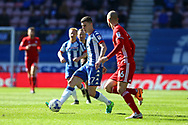 Ryan Colclough of Wigan Athletic gets past Matthew Connolly of Cardiff City. EFL Skybet Championship match , Wigan Athletic v Cardiff city at the DW Stadium in Wigan, Lancs on Saturday 22nd April 2017.<br /> pic by Chris Stading, Andrew Orchard sports photography.