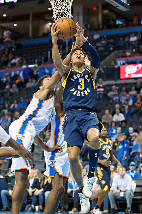OKLAHOMA CITY, OK - OCTOBER 25:  Joe Young #3 of the Indiana Pacers drives to the basket during a game against the Oklahoma City Thunder at the Chesapeake Energy Arena on October 25, 2017 in Oklahoma City, Oklahoma.  NOTE TO USER: User expressly acknowledges and agrees that, by downloading and or using this photograph, User is consenting to the terms and conditions of the Getty Images License Agreement.  The Thunder defeated the Pacers 114-96.  (Photo by Wesley Hitt/Getty Images) *** Local Caption *** Joe Young