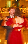 A young couple hold each other on the dance floor during a tea dance at the Palm Court, Waldorf Hilton Hotel in Aldwych.