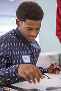 Purchase, NY – 31 October 2014. Port Chester High School student Lance Tennyson taking notes. The Business Skills Olympics was founded by the African American Men of Westchester, is sponsored and facilitated by Morgan Stanley, and is open to high school teams in Westchester County.