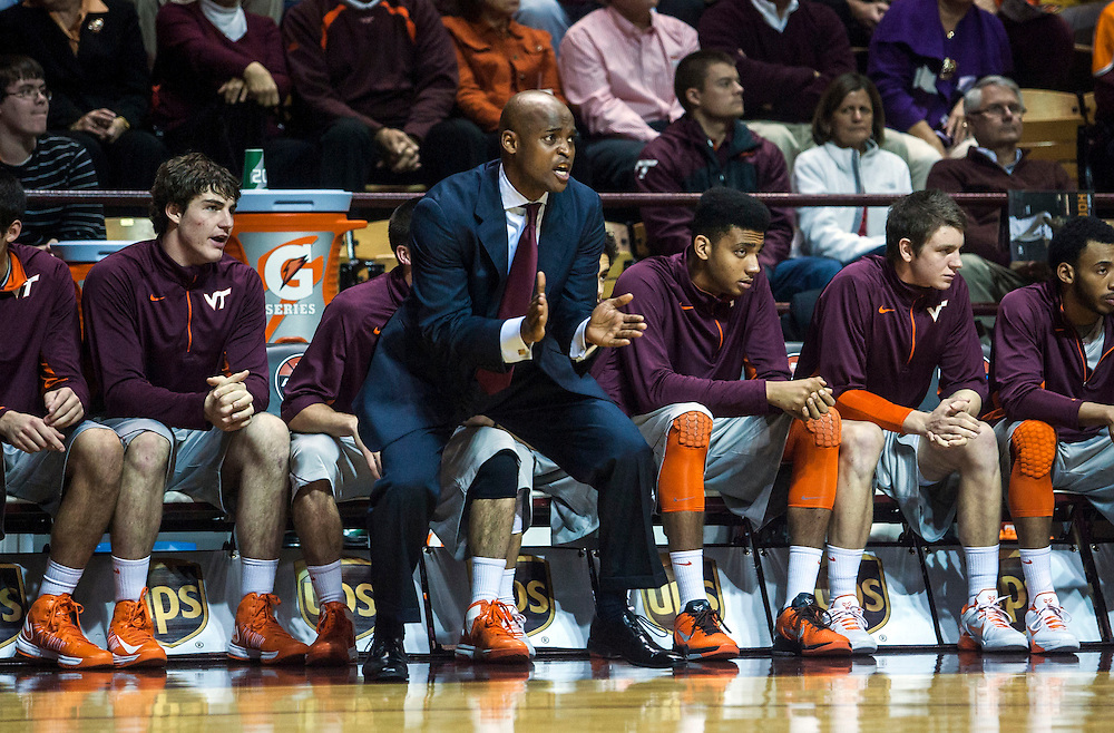 Nov 27, 2012; Blacksburg, VA, USA; Virginia Tech Hokies head coach James Johnson reacts from the bench during the game against the Iowa Hawkeyes at Cassell Coliseum. Mandatory Credit: Peter Casey-USA TODAY Sports