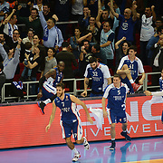 Anadolu Efes's players celebrate victory during their Turkish Airlines Euroleague Basketball Group A Round 5 match Anadolu Efes between Real Madrid at Abdi ipekci arena in Istanbul, Turkey, Thursday, November 14, 2014. Photo by Aykut AKICI/TURKPIX