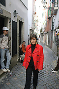 Fado singer Katia Guerreiro is one of the young singers generation  that are bringing a new strenght to this traditional kind of portuguese music. Here Katia is walkinh in the old Lisbon neighborhood of Alfama.