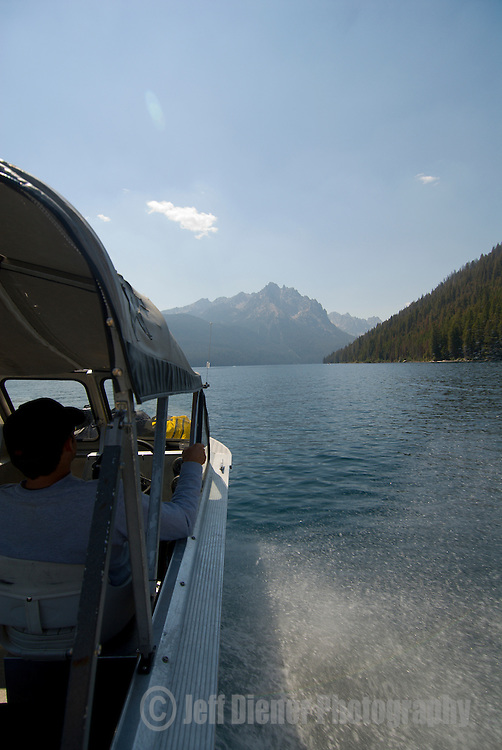 A boat shuttle races across Redfish Lake in the Sawtooth National Forest, Idaho.