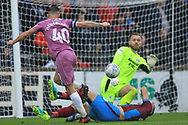 Jack Alnwick saves from Ian Henderson during the EFL Sky Bet League 1 match between Scunthorpe United and Rochdale at Glanford Park, Scunthorpe, England on 8 September 2018.