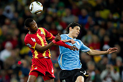 John Pantsil of Ghana vs Edinson Cavani of Uruguay  during to the 2010 FIFA World Cup South Africa Quarter Finals football match between Uruguay and Ghana on July 02, 2010 at Soccer City Stadium in Sowetto, suburb of Johannesburg. (Photo by Vid Ponikvar / Sportida)