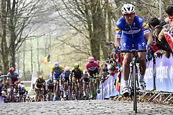 March 25, 2018 - Wevelgem, BELGIUM - Belgian Philippe Gilbert of Quick-Step Floors pictured in action on the cobblestones of the Kemmelberg during the 80th edition of the Gent-Wevelgem cycling race, 251,1 km from Deinze, near Gent, to Wevelgem, Sunday 25 March 2018. BELGA PHOTO DIRK WAEM (Credit Image: © Dirk Waem/Belga via ZUMA Press)