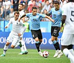 NIZHNY NOVGOROD, July 6, 2018  Lucas Torreira (C) of Uruguay vies with Antoine Griezmann (L front) of France during the 2018 FIFA World Cup quarter-final match between Uruguay and France in Nizhny Novgorod, Russia, July 6, 2018. (Credit Image: © Liu Dawei/Xinhua via ZUMA Wire)