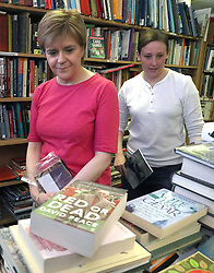 First Minister Nicola Sturgeon and the SNP's local candidate Mhairi Black (right) visit a book shop while on the general election campaign trail in Paisley.
