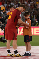 As Roma vs Genoa as part of Series A at the Stadio Olimpico in Rome, Italy. 28 May 2017 Pictured: Francesco Totti dona la fascia da capitano ad un bambino Last Match of Francesco Totti. Ultima Partita di Francesco Totti. Photo credit: Insidefoto / MEGA TheMegaAgency.com +1 888 505 6342