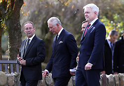 The Prince of Wales (centre) and First Minister of Wales Carwyn Jones (right) leave the Aberfan Memorial Garden in Wales, during a visit to the village on the 50th anniversary of the Aberfan disaster.