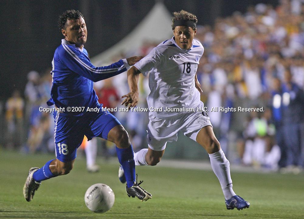 Honduras's Jairo Martinez (r) tries to get around El Salvador's Alexander Escobar (l) on Tuesday, March 27th, 2007 at SAS Stadium in Cary, North Carolina. The Honduras Men's National Team defeated El Salvador 2-0 in a men's international friendly.