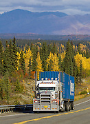 Alaska. Scenic autumn view of a semi-truck traveling south through Broad Pass, south of Cantwell, on the Parks Highway.