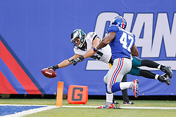 Philadelphia Eagles tight end Trey Burton #47 carries the ball for a touchdown after recovering a blocked punt during the NFL game between the Philadelphia Eagles and the New York Giants at MetLife Stadium in East Rutherford, New Jersey on Sunday, December 24th 2014. The Eagles won 34-26. (Brian Garfinkel/Philadelphia Eagles)