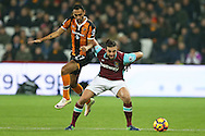 Andy Carroll of West Ham United holds off Ahmed Elmohamady of Hull City. Premier league match, West Ham Utd v Hull city at the London Stadium, Queen Elizabeth Olympic Park in London on Saturday 17th December 2016.<br /> pic by John Patrick Fletcher, Andrew Orchard sports photography.