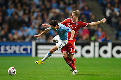 Man City Midfielder Jesus Navas (ESP) is tackled by Bayern Midfielder Toni Kroos (GER) during the first half of the match - Photo mandatory by-line: Rogan Thomson/JMP - Tel: Mobile: 07966 386802 - 02/10/2013 - SPORT - FOOTBALL - Etihad Stadium, Manchester - Manchester City v Bayern Munich - UEFA Champions League Group D.