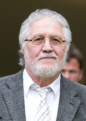 © London News Pictures. 03/10/2013 . London, UK.   Radio DJ DAVE LEE TRAVIS  leaving Westminster Magistrates court in London where he faced charges of two counts of indecent assault on a woman aged over 16 between 1992 and 1993. Travis has already appeared in court to face the original 12 charges, which include indecent assault and sexual assault. Photo credit : Ben Cawthra/LNP