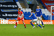 Millwalls's Maikel Kieftenbeld (16) under pressure from Cardiff City's Joe Ralls (8) during the EFL Sky Bet Championship match between Cardiff City and Millwall at the Cardiff City Stadium, Cardiff, Wales on 30 January 2021.