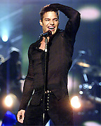 """Recording artist, Ricky Martin performs his hit song, """"Loaded"""" at the Miss Universe competition in Bayamon, Puerto Rico, May 11, 2001."""