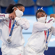 TOKYO, JAPAN - JULY 27: Simone Biles and Jordan Chiles of the United States react after receiving their silver medals during the Team final for Women at Ariake Gymnastics Centre during the Tokyo 2020 Summer Olympic Games on July 27, 2021 in Tokyo, Japan. (Photo by Tim Clayton/Corbis via Getty Images)