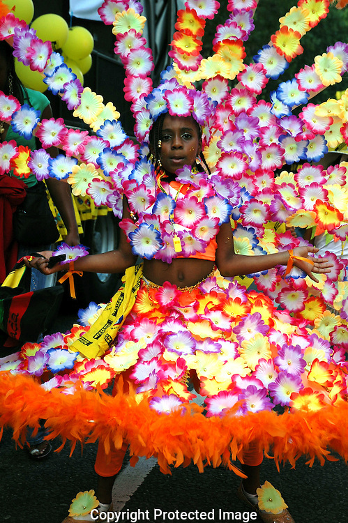 Children dressed in colourful costumes taking part in the annual Notting Hill Gate Carnival  in West London.