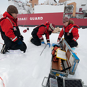 Brenna McConnell, Metta Kaufman and Cristina Galvan working on ice core samples from the ice of the Arctic Ocean.