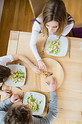 Family fighting for last slice of pizza