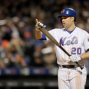 NEW YORK, NEW YORK - APRIL 27:  Neil Walker #20 of the New York Mets cleans the dirt from his bat while batting during the New York Mets Vs Cincinnati Reds MLB regular season game at Citi Field on April 27, 2016 in New York City. (Photo by Tim Clayton/Corbis via Getty Images)
