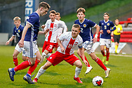 Jamie Hamilton (Hamilton Academical) takes the ball from Michal Rakoczy during the U17 European Championships match between Scotland and Poland at Firhill Stadium, Maryhill, Scotland on 26 March 2019.