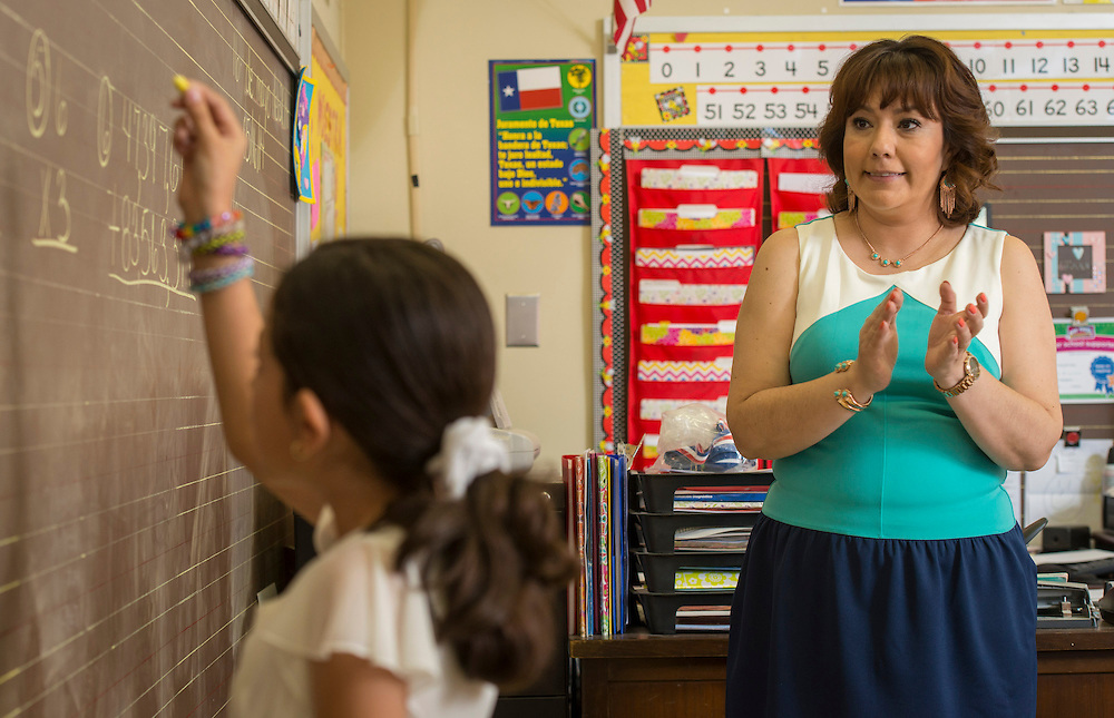Sharon Samuel works math problems with her second graders at J.P. Henderson Elementary School, May 16, 2014.