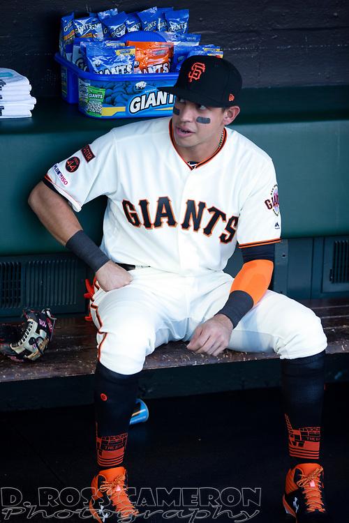 San Francisco Giants rookie second baseman Mauricio Dubon  sits in the dugout before a baseball game, Thursday, Aug. 29, 2019, in San Francisco. (AP Photo/D. Ross Cameron)