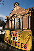 Protest banners outside Carnegie Library in Herne Hill, south London while occupiers remain inside the premises on day 6 of its occupation, 5th April 2016. The angry local community in the south London borough have occupied their important resource for learning and social hub for the weekend. After a long campaign by locals, Lambeth have gone ahead and closed the library's doors for the last time because they say, cuts to their budget mean millions must be saved.